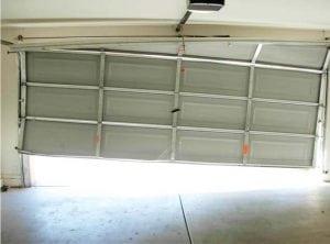 damaged garage door Boulder Garage Doors
